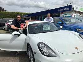 Think Cars' Kristian Robinson with Darren Cooper, managing director of the Peter Cooper Motor Group