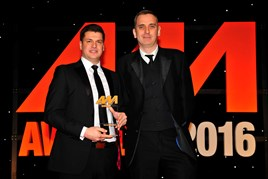 Lee Manning, digital marketing manager, Perrys Motor Sales (left), collects his award for Best Use of Television and/or Video from Jeremy Bennett, head of digital, AM