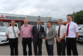 Celebrating its 2016 Mitsubishi milestone (left and right): Livery Dole sales consultant Peter Ackford, chairman Nigel Clegg, sales and marketing director at Mitsubishi Motors in the UK Toby Marshall, managing director Hayden Williams, service manager Chris Ellison and workshop manager Andrew Godbeer