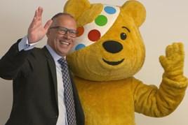 Lookers managing director, Allan Rushforth, welcomes Pudsey Bear
