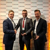 Lookers rising star Brad Baker (centre) celebrates his award with Matt Clay (right), Lookers group qualifications manager, and Steve Maule, group head of qualifications and diversity.