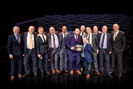 Gary Savage chief executive of Mercedes-Benz UK, Marcus Breitschwerdt, head of mercedes-benz region Europe (extreme right), David Currin, sales director at Lookers Mercedes-Benz Kent holding the trophy, and Lookers chief executive Andy Bruce (third from the right).