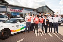 Staff at Lookers Nissan Leeds and representatives of Stonewall fly the flag for diversity