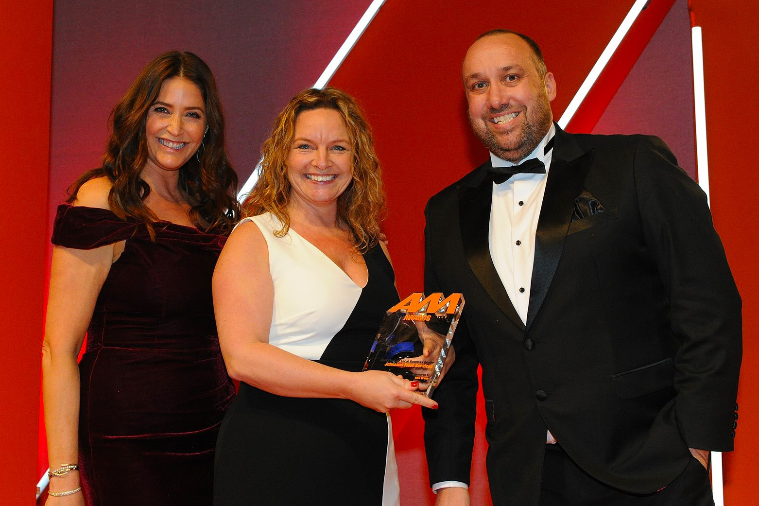 Louise Baker, head of fleet operations, Johnsons  Fleet Services, accepts the award from  Declan Gaule, chief executive, MFG Group, right, and host Lisa Snowdon, left