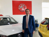 Minstergate chief executive, Mark Campey, celebrates his business' new MG dealerships' opening