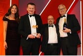 Mark Lavery, chief executive, Cambria Automobiles, accepts the award from AM editor Tim rose, second from right, Ian Simpson, sales and marketing director, Premia Solutions, right, and host Lisa Snowdon, left