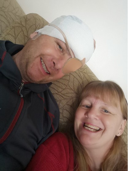 Car dealer Mark Calaz recovering from surgery last year with the help of his wife, Mandy