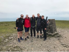 Marriott Motor Group's directors celebrate their successful completion of their Yorkshire Three Peaks fund-raising challenge