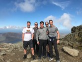New heights (from left): Marriott Motor Group's Ian Woodward, Steve Bridges, Paul Barnard, Robert Rolfe and Austin Seales reach the peak of Snowdon to complete their Three Peaks charity challenge
