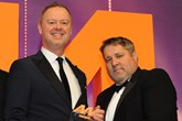 Martin Sewell, managing  director, Rockar, collects the  award from Nathan Elliott,  head of sales, Autino, right