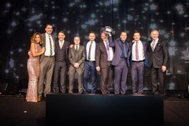 Sinclair Group representatives collect their Mercedes Benz Retailer of the Year award