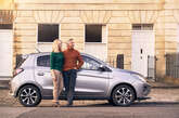 Couple standing near vehicle