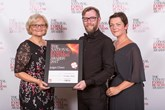 Ryan Forsythe, marketing manager, John Mulholland Motor Group and his wife Jennifer Forsythe (Right) receive the award from Diane Birch, executive director, British & Irish Trading Alliance