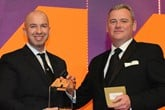 Nathan Tomlinson, managing director, Devonshire Motors, collects the award from  Christian Jamison, client service  director, Rhino Events, right