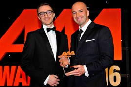 Nathan Tomlinson, managing director, Devonshire Motors (right), collects the award from Nathan Cooper, commercial and business development manager, EMaC
