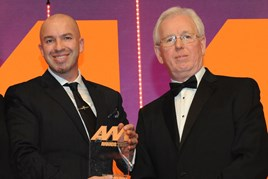 Nathan Tomlinson, managing director, Devonshire Motors, collects the award from  Richard Lailey, director, Autoguard Warranties, right