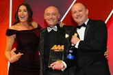 Neil Smith, operations director,  Imperial Cars, collects the award from  Kevin Brockbank, core sales director,  Santander Consumer Finance, right, and host Lisa Snowdon, left