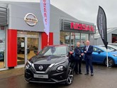 Patricia McIntosh collects her 27th new Nissan, a new Juke, from Crayford & Holt director Kevin Abbs