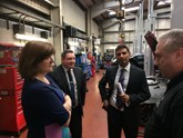 The chairman of the government's Treasury Select Committee, Nicky Morgan MP (left), took a tour of Loughborough Mercedes-Benz with general manager Dougie Singh (second right)