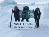 Aston Barclay on top of the world: Break-Point director Jason 'Foxy' Fox (centre) with two of his fellow adventurers hoisting the Aston Barclay banner