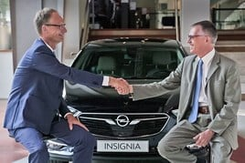 Opel chief executive Michael Lohscheller and PSA Group chief executive, Carlos Tavares (right)