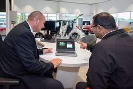 Paul McNeil from Bristol Street Motors Citroen with a customer