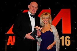 Philip Crossman, managing director, Honda UK (left), collects the award for New Car of the Year from Sue Healey, key account manager, Supagard