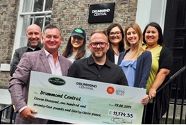 Paul Keighley, PK Motors' managing director, hands over a cheque for over £11,000 to Dan Appleby and members of the fundraising team at Drummond Central