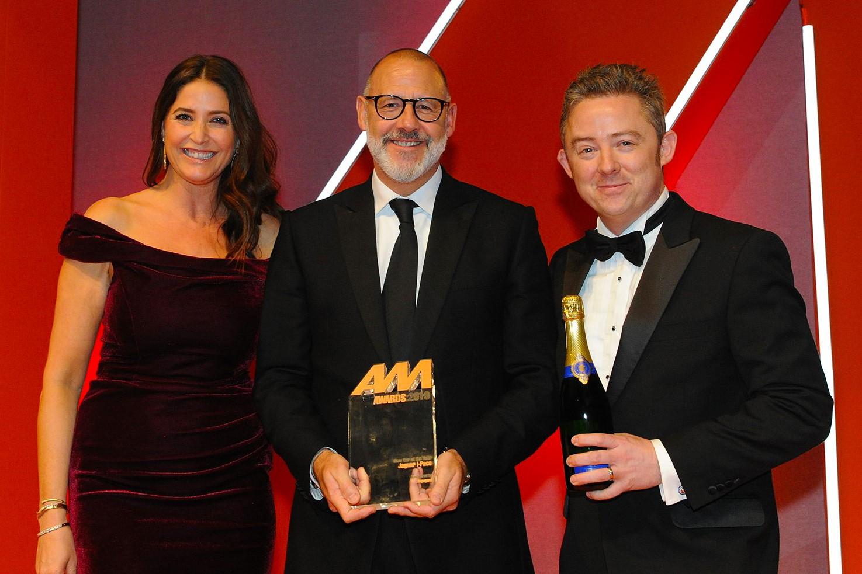 Rawdon Glover, UK managing  director, Jaguar Land Rover,  collects the award from  David Paterson, marketing  director, Supagard, right, and Lisa Snowdon, left