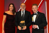 Rawdon Glover, UK managing  director, Jaguar Land Rover,  collects the award from  David Paterson, marketing  director, Supagard, right, and Lisa Snowdon, left