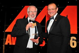 Reg Tutt, managing director, Sandicliffe (left), accepts the award for Most Improved Dealership from Neil Pursell, managing director, Martec Europe