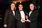 Paul Ward, director of Shelbourne Motors (centre) collects the award from Darren Payne, Sales Director at Renault UK, and Ken Ramirez, Managing Director of Renault UK