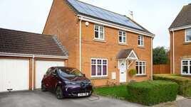 Renault Zoe charging outside home