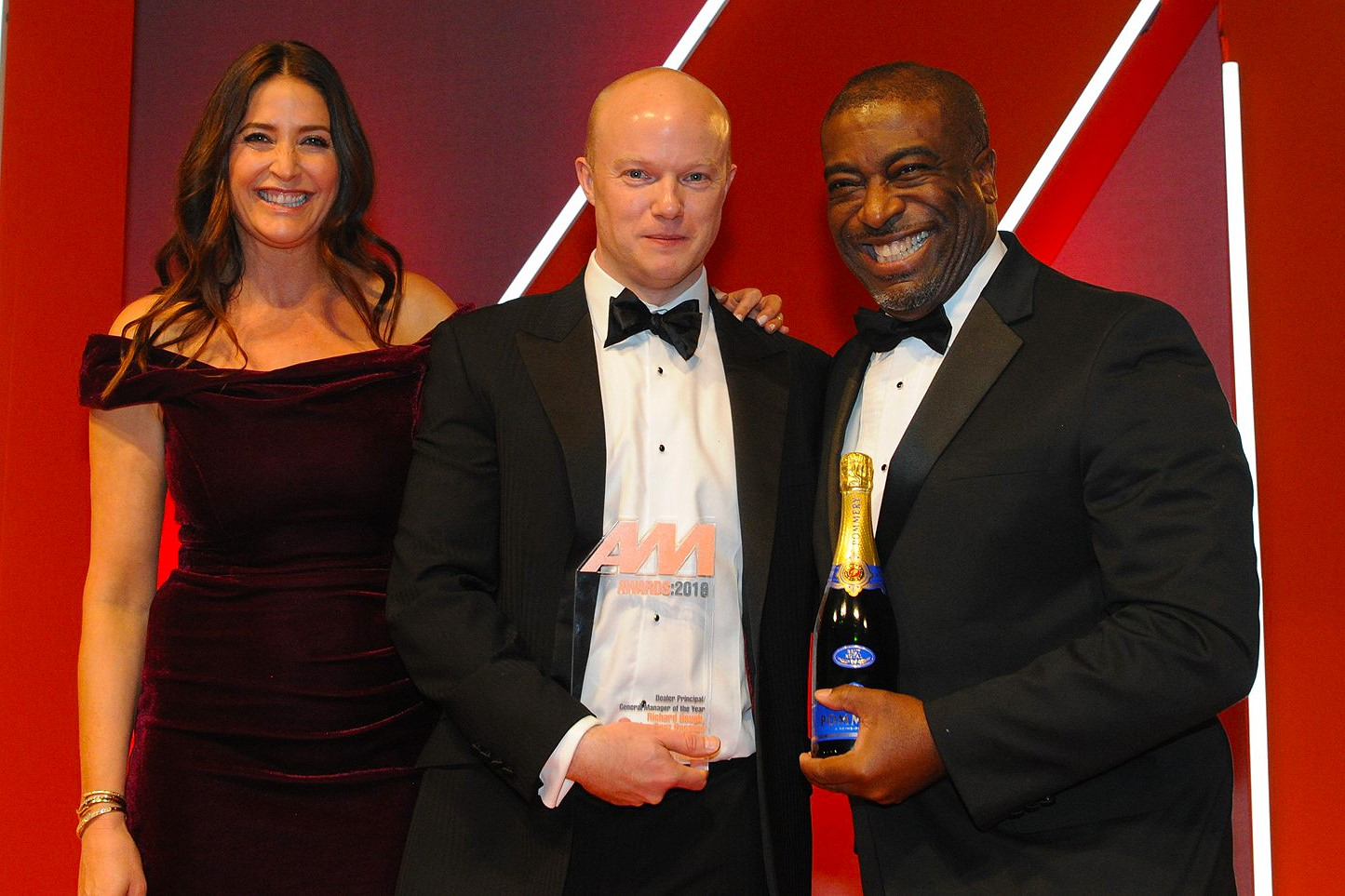 Richard Gough, general manager, Mercedes-Benz of Preston, accepts the award from Andrew Landell, managing director, LTK Consultants, right, and Lisa Snowdon, left