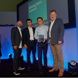 Jacob Freshwater (holding award) collects his Auto Trader Retail Awards Rising Star accolade alongside his brother Isaac last month