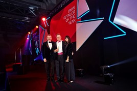 BMW UK chief executive Graeme Grieve (left) presents the Retailer of the Year award to Nigel Marsh, head of business at Sytner Sheffield, with event host Claudia Winkleman