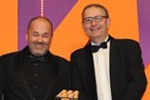 Robin Luscombe, managing director, Luscombe Motors, collects the award from Adrian  Willard, sales director, EMaC, right