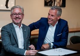 JCT600 chief executive John Tordoff with Rolls-Royce Motor Cars chief executive Torsten Müller-Ötvös