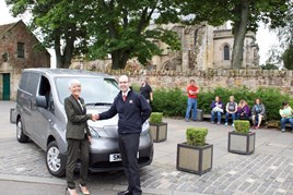 Rosslyn Chapel Trust's finance and administration manager, Audrey Jones, with Alastair Loudon, EV specialist at Alex F Noble & Son Nissan.