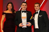 Russell Borrie, group franchise director, Arnold Clark Automobiles,  accepts the award from Richard Jones, managing director – motor  finance and leasing, Lloyds Banking Group, right, and host Lisa Snowdon, left