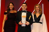 Russell Borrie, group franchise director, Arnold Clark Automobiles, accepts the award from Wendy Harris,  vice-president European sales, CarGurus, right, and host Lisa Snowdon, left