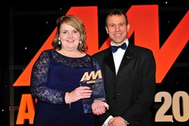 Sarah Eccles, group fleet sales director, Swansway Group (left), accepts the award for Best Fleet Operation from Stephen Briers, editor-in-chief, AM