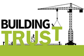 Crane carrying the words 'building trust'