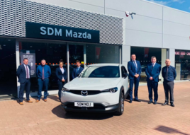 SDM Mazda's (from left) Steven Learmonth, Lewis Wood, Helen Aitken, Niall Syme and John Mallis with Mazda UK Head of Network Strategy Brett Hague and sales director Peter Allibon