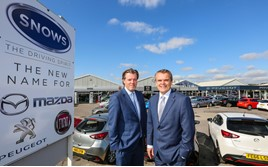 Snows Group board director Neil McCue (left), with group chairman Stephen Snow, outside its new multi-brand site in Portsmouth