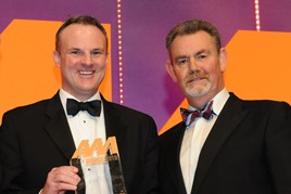 Simon Hetherington, commercial director, Kia Motors UK, collects the  award from Philip Morrison, head of corporate sales, Car Care Plan, right
