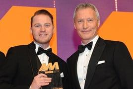 Simon Priest, centre principal,  Porsche Centre Wolverhampton, collects the award from Mark Gow, sales director, DSG Finance, right