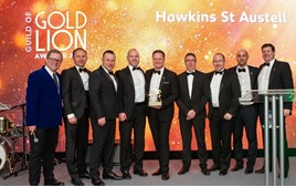 Comedian John Culshaw (left), Peugeot UK managing director David Peel (centre, with award) and Peugeot UK sales director Simon Bisp, present Hawkins Motor Group's team with their Golden Lion award