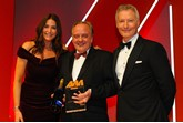 Stuart Foulds, chairman and chief executive, TrustFord, accepts the award from Mark Gow, sales director, DSG Finance, right, and host Lisa Snowdon, left