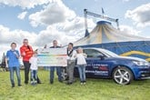 Swansway Garages director David Smyth and children, George, Henry and Francesca present Circus Starr with £13,200.